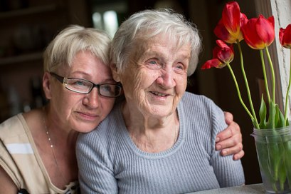 stock-photo-happy-elderly-woman-with-her-daughter-in-behind-an-embrace-453160732